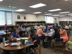 Teachers collaboratively working together